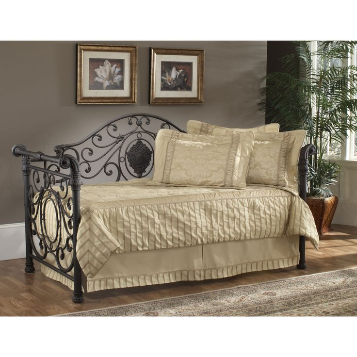 This Victorian daybed offers an old world style with the elegance of a sleigh design. The back features a decorative large medallion accented by smaller, sophisticated castings while elegantly scrolled arms complete the look.