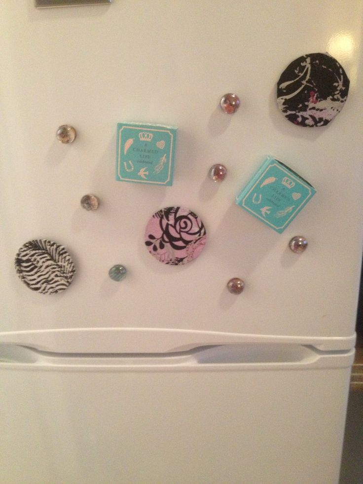 My fridge magnets, glass beads and pictures. Small boxes, and metal circles the magnets came on covered in fabric ad glued to a magnet. :) circles are my fave. Have larger glass beads to try with photos to make necklace pendants.