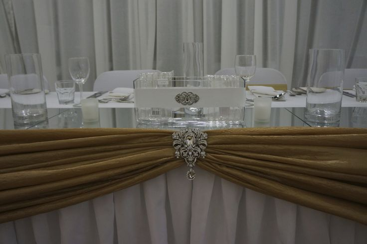 Gold sash on the bridal table beautifully pinned.  Styled by https://www.facebook.com/pwseventstas  Contact us for details for your wedding.   http://www.tailracecentre.com.au/contact/