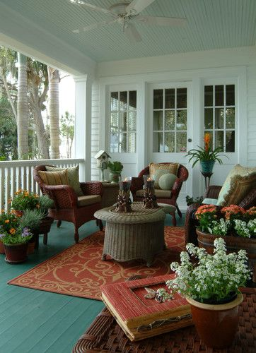 Would LOVE a ceiling fan on my porch and look at the painted floor.