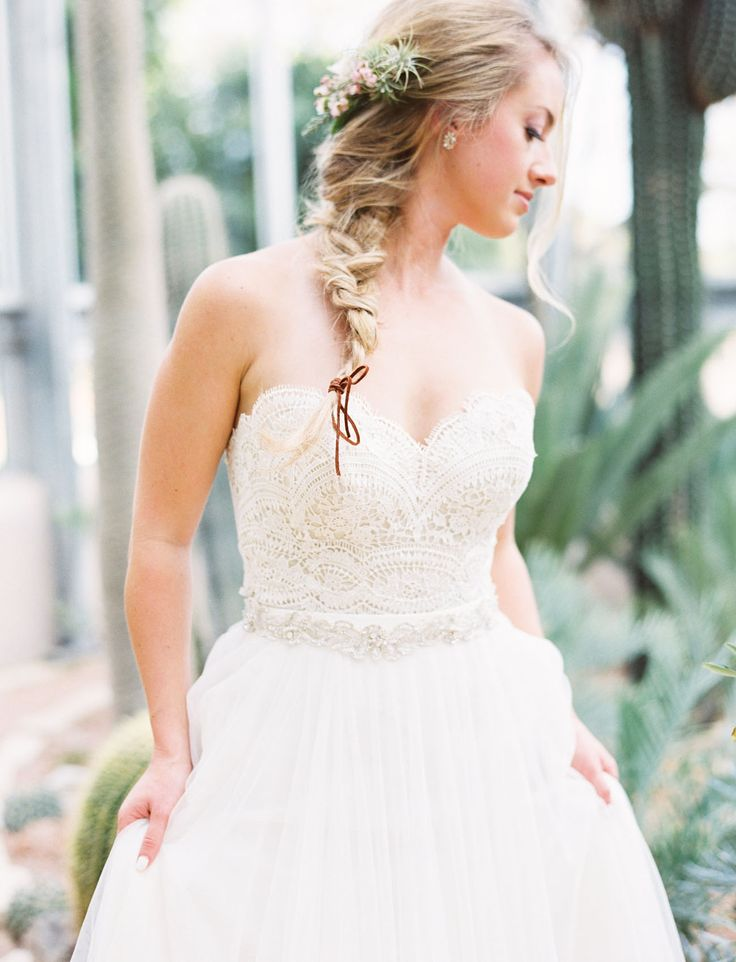 Braided hair tied with leather for the bride