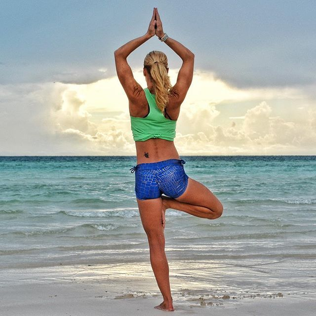Day 20 of #theheartofpractice is #Vrksasana or Tree Pose. This photo was taken 2 years ago in beautiful Eleuthera. I love this island so much that I dream of permanent residence there.🌴🐚🌞#someday _ This foundational pose tests both your strength and balance. It can be quite challenging for beginners or people with tight hips and shoulders. Modifications can be to place foot on calf and/or keep hands at heart center.  Tips: ✨Engage the standing leg✨Draw in the belly and engage the pelvic…
