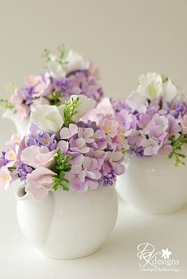 Floral Centerpieces, spring lavender and pink flowers in  solid white tea pots or creamers...
