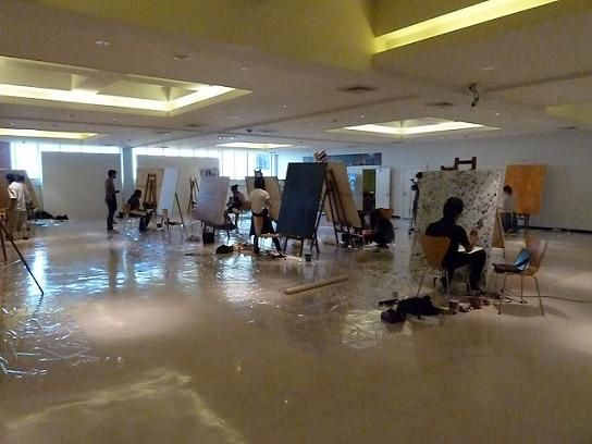 Artists at work at the Queens Gallery in Bangkok, Thailand