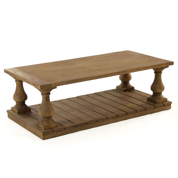 Blending traditional and farmhouse styles, the Beaufort coffee table lends transitional sofas a sophisticated partner. Featuring wide wooden slats, a rectangular base supports elegantly turned legs for compelling style. A simple top maintains the rustic vibe. 55.25in W x 27.5in D x 18.5in H. Apron to floor: 17.25in H. Between legs: 41.75in W x 14.25in D. Oak.