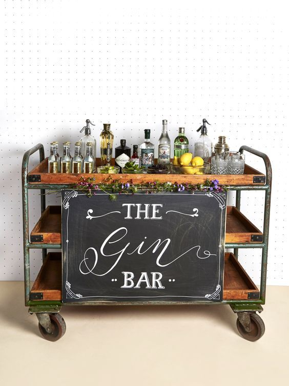 Create your own gin station with varieties of gin, lemons, cucumbers, herbs and flavoured tonics. Image: Pinterest