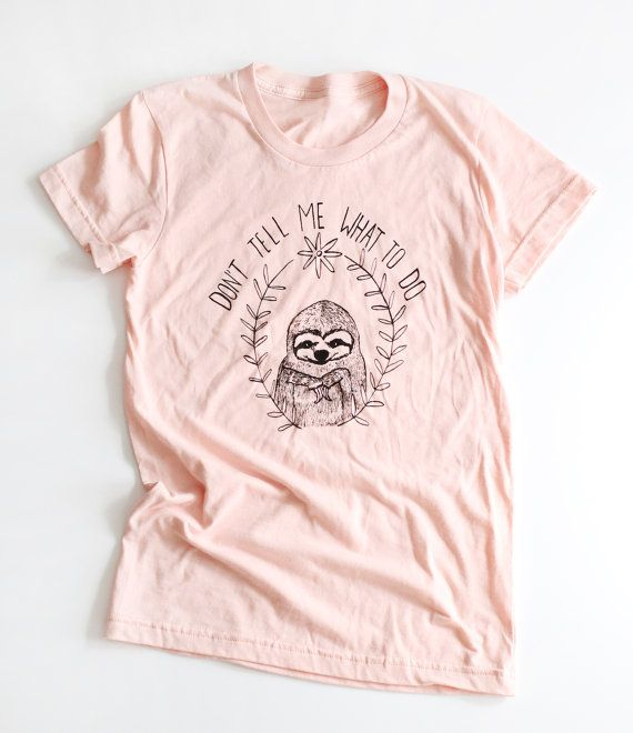 Sloths do what they want and so should you.    Printed on a summer peach unisex American Apparel shirt. 100% cotton.