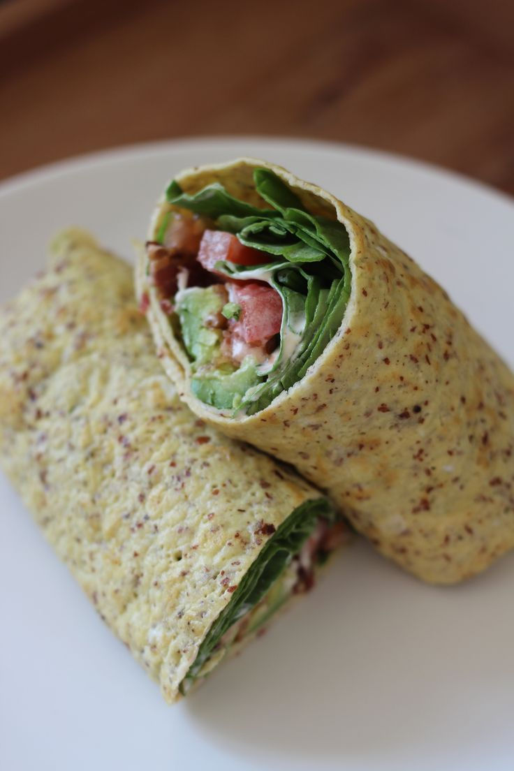 "I decided to adapt my Paleo crepe recipe to make a savory crepe that could  be used in place of a tortilla for breakfast wraps. Instead of a fruit  filling, I made a kind-of Paleo BLT wrap, plus avocado and with spinach  instead of lettuce.  Ingredients (Makes about five large ""tortillas""):      * Ten eggs     * Six tablespoons almond flour     * Three tablespoons arrowroot powder     * One teaspoon garlic powder     * Salt and pepper, to taste     * Filling: Bacon, lettuce or spinach…"