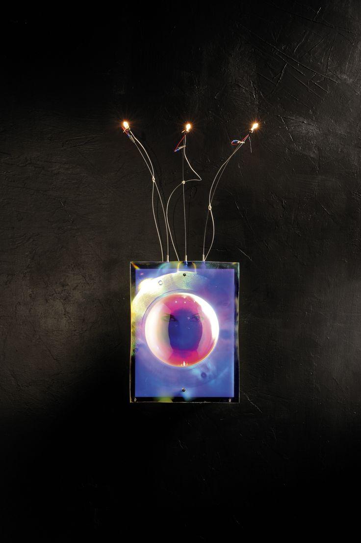 #ARGENS. Base: In metallo cromato Steli: Cromati Frontale: Plexiglas iridescente Particolarità: Occhi serigrafati all'interno Base: Chrome metal Stems: Chrome Front panel: Iridescent plexiglass  Bulb: Double plug-in halogen and fluorescent Lucifero Iluminazione srl - All Rights Reserved  #UpsetDesign #Lucifero #LuciferoIlluminazione #lamp #lampada #floorlamp #design Crazy Lamp #creative# lamp# design