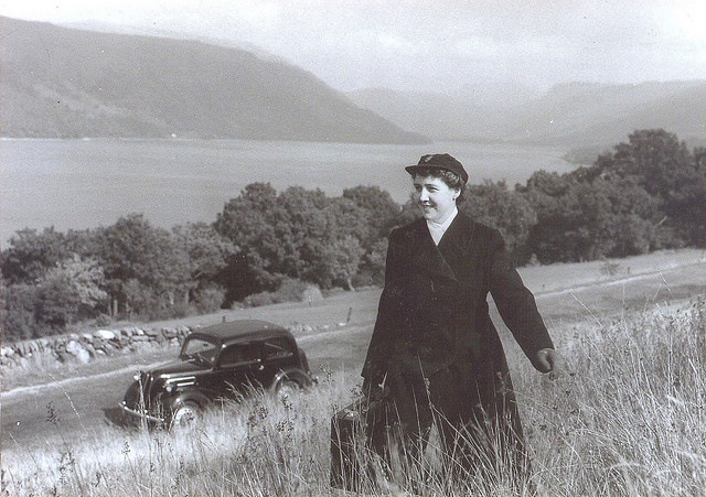 A traveling nurse makes her way up a grassy hill located in Argyll, Scotland in this lovely image from 1959.