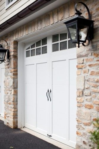 Garage doors | More here: http://mylusciouslife.com/stylish-home-luxury-garage-design/