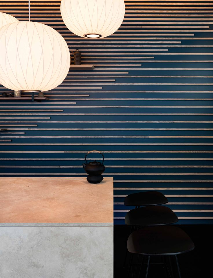 Interior design for Karma Sushi Restaurant, Aarhus, Denmark. Three natural core materials and a deep Scandinavian blue gives a Nordic atmosphere that is combined with a Japanese tranquility elegance.