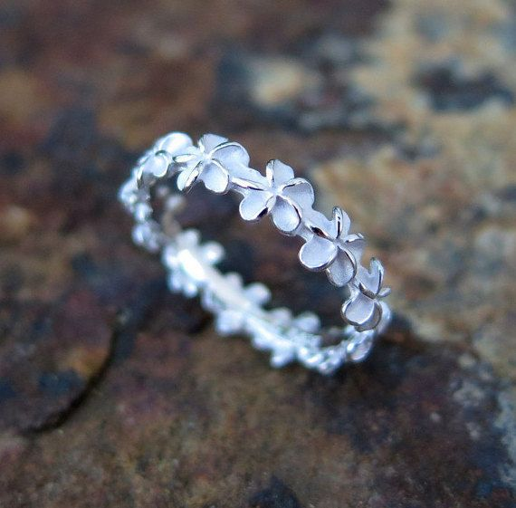 Handmade Hawaiian ring featuring a classic plumeria flower lei design. Made of 925 sterling silver. Available in sizes 3 thru 10.  Design #27