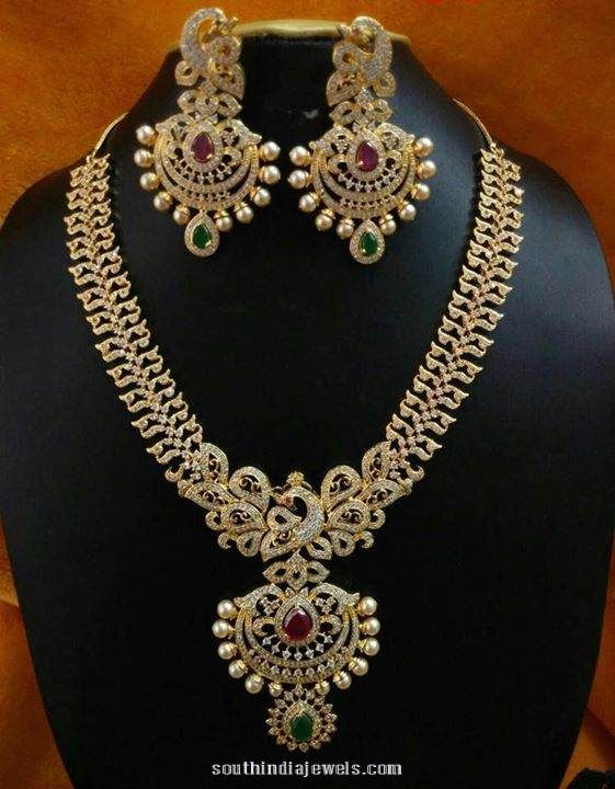 Stunning 1 gram gold stone necklace set with earrings. The necklace is embellished with semi precious rubies and emeralds.