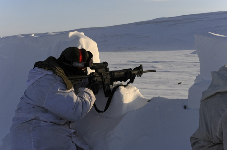 A Canadian Forces soldier fires from an improvised defensive position as the Winter Warfare Advanced Course conducts a live-fire small-arms shoot outside Resolute Bay, Nunavut.