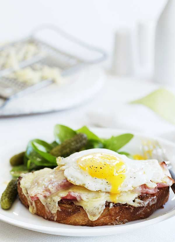 croque madame with spinach salad. Topped with bubbling cheese and a runny egg, this classic French recipe makes a hearty weekend brunch