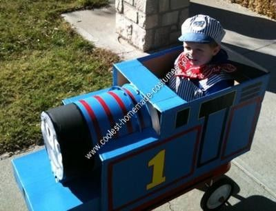 Homemade Thomas the Tank Engine Child Halloween Costume Idea: My son is a really big Thomas the Tank Engine fan, so I decided I would take the plunge to make him his own Thomas to ride in (this homemade Thomas the