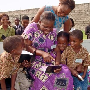 People looking at the New World Translation of the Holy Scriptures in Congo (Kinshasa).. Jehovah's happy people