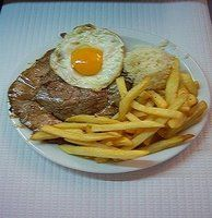 Bitoque- Portuguese Steak with fried egg. rice and french fries. Delicious