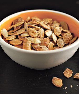 Scoop out the pumpkin, wash the seeds, dry, toss in melted butter, sprinkle with sugar and salt, bake in slow oven, low heat.....Sweet and salty Pumpkin Seeds