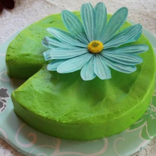 Frog baby shower theme! I bought the flower at Hobby Lobby. The inside of the cake was confetti cake. It was a real hit! I bought a cake board at Michael's and covered it with wrapping paper.