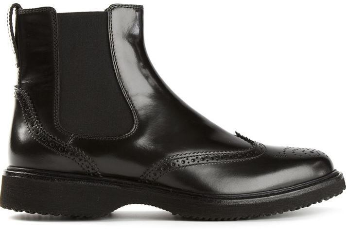 $300, Black Leather Brogue Boots: Hogan Brogue Chelsea Boots. Sold by farfetch.com. Click for more info: https://lookastic.com/men/shop_items/275771/redirect
