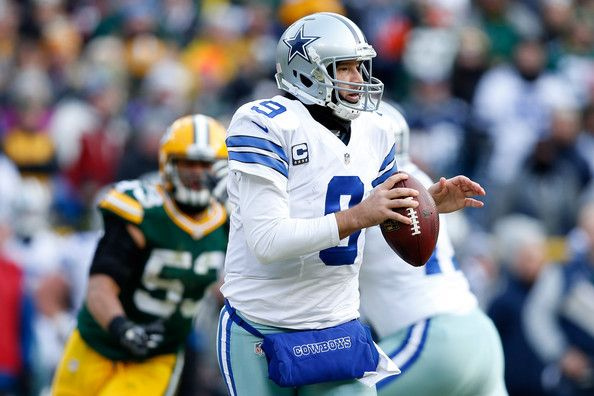 Tony Romo Photos Photos - Quarterback  Tony Romo #9 of the Dallas Cowboys looks to pass in the second quarter of the 2015 NFC Divisional Playoff game against the Green Bay Packers at Lambeau Field on January 11, 2015 in Green Bay, Wisconsin. - Divisional Playoffs - Dallas Cowboys v Green Bay Packers
