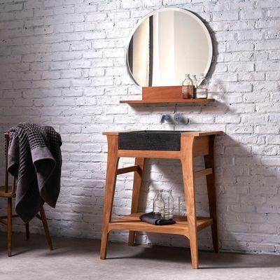 Meuble avec vasque en Teck 70 Mya. Dimensions : H. 90 x L. 70 x P. 50 cm. Poids : 33 Kg. Vasque encastrable en Terrazo brut non traité, dimensions : H.12 x L. 45 x P. 40 cm. 499 euros. Tikamoon.