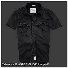 has the color between black and gray with a white colored light stripes  is a black shirt and gray colored, short sleeves without accessories, with a round neck casual style and flair has a cost of 354 pounds
