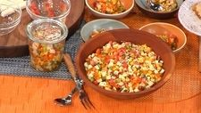 South-of-the-Border Chow-Chow  Ingredients  4 cups vegetables, diced into 1/2 inch pieces (use any combination of corn, jicama, tomatoes, garlic, red onions, bell peppers, chili peppers, etc.) 1 tablespoon extra-virgin olive oil 1 tablespoon white vinegar 1 tablespoon fresh lime juice 1/8 teaspoon salt Freshly ground black pepper 1 tablespoon fresh cilantro, chopped 1 tablespoon fresh oregano, chopped Dash chili powder Dash cumin Optional: dash (or more) of hot sauce