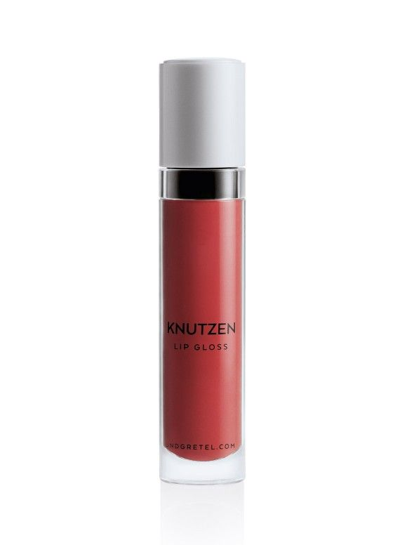 KNUTZEN Lipgloss for grownups. Four beautifully wearable colours in two finishes. One is a glimmering, high-shine formula that delivers a translucent kiss of colour that can be worn alone or on top of TAGAROT Lipstick for a plumping effect. The other is a uniquely matte, saturated liquid lip colour that delivers a creamy, high-pigment tint. Infused with regenerating Vitamin E and a fresh citrus scent, this non-sticky formula is also perfectly kissable.