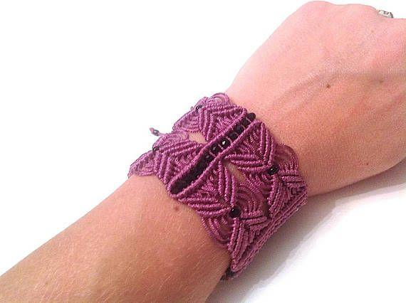 Handmade macrame bracelet with crystal beads and adjustable closure.