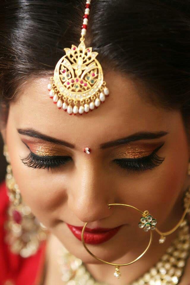 traditional indian bride with maang tika and nath, indian bridal makeup
