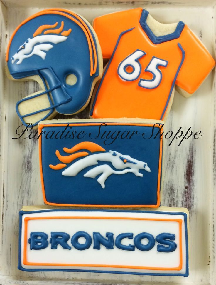 Denver Broncos football helmet decorated cookies by Paradise Sugar Shoppe