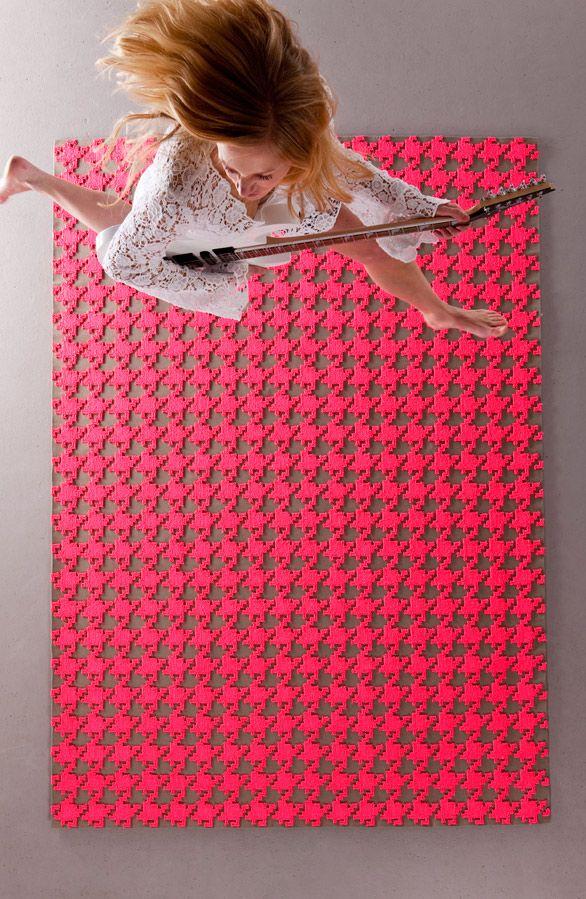 Hot pink houndstooth rug, by German rug-makers Floor to Heaven.  Via Cool Hunting.