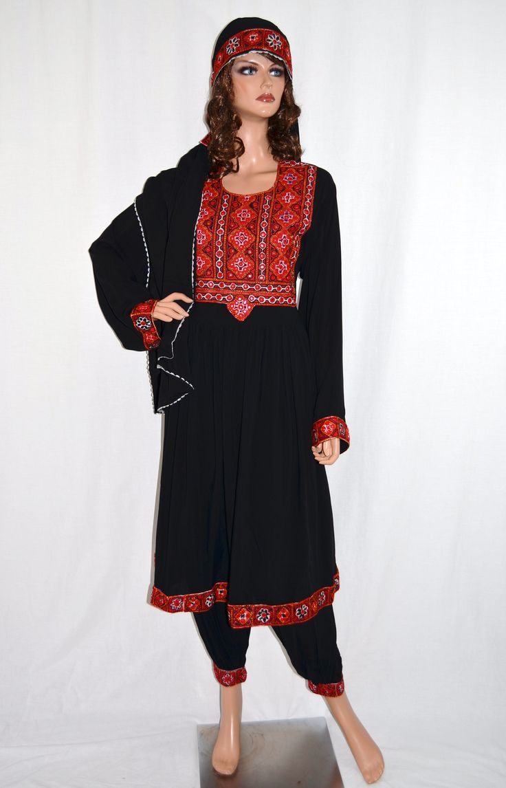 "Nazirah Black Kuchi Dress.  Beautifully embroidered traditional Afghan Kuchi tribal dress in black. The material is soft, breathable, and light weight, perfect for the summer! Comes with matching pants, head scarf, and adjustable belt at the waist. The measurement of the bust is 22"" from seam to seam, and the length is 40"" long from the back. Size: Small to Large (Depending on bust size) http://www.zarinas.com/dresses2.shtml"