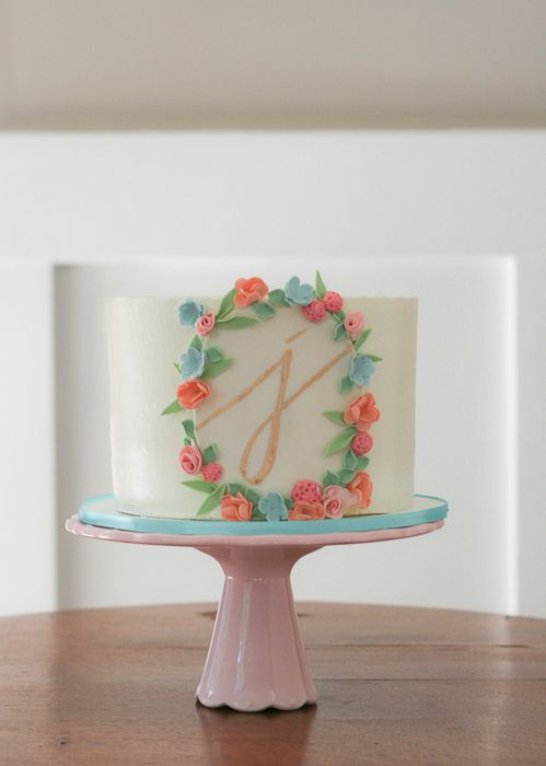 buttercream with hand-painted initial by erica obrien cake design blog
