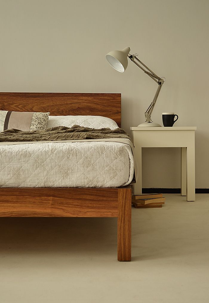 A one-off Sahara bed in a solid African hardwood from www.naturalbedcompany.co.uk