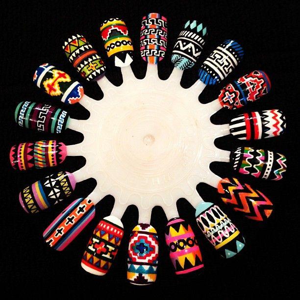 Check out that detail!  Tribal nail art.