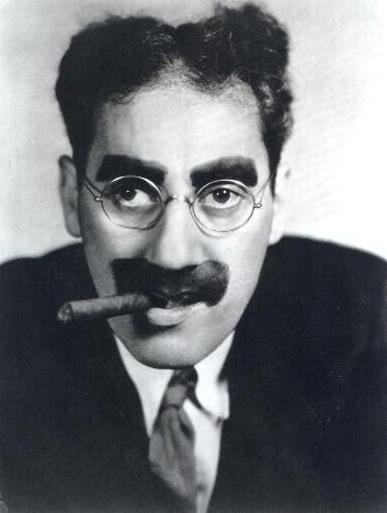 "Groucho Marx (1890 - 1977) Leader of the Marx Brothers, appeared in the movies ""Animal Crackers"", ""Duck Soup"" and ""A Day at the Races"", was the host of the TV game show ""You Bet Your Life"""