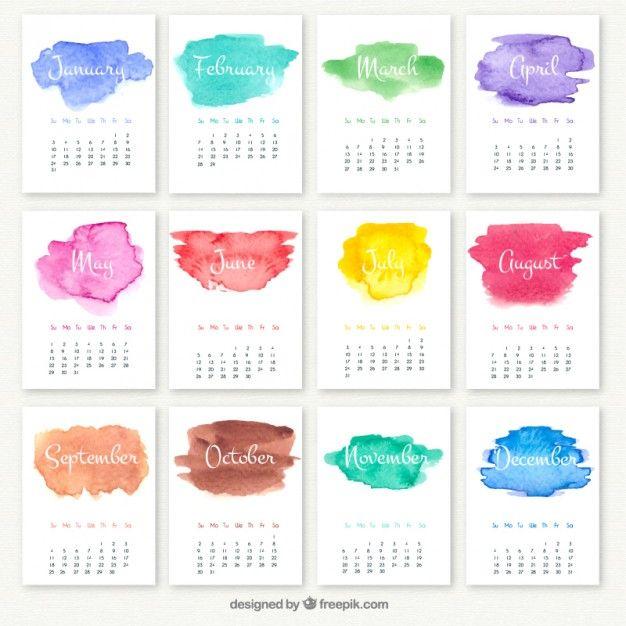 Calendário anual com manchas de aquarela Vetor grátis