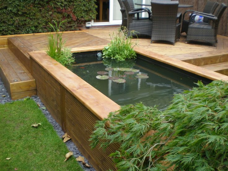 14 best decking with pond images on pinterest backyard for Raised koi pond ideas