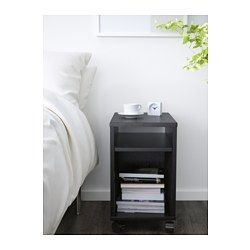 IKEA - OLTEDAL, Nightstand, black-brown, , Real wood veneer will make this nightstand age gracefully.Easy to move - casters included.Room on the shelf for an outlet strip for your charger.You can run the plug to the outlet through the back.