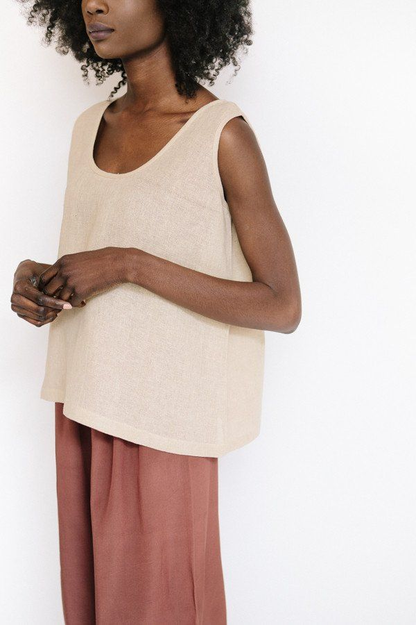 Revisited Matter Jute Tank Top in beige pink features a straight boxy fit, slightly see through and the perfect summer staple. Also available in black and ma...
