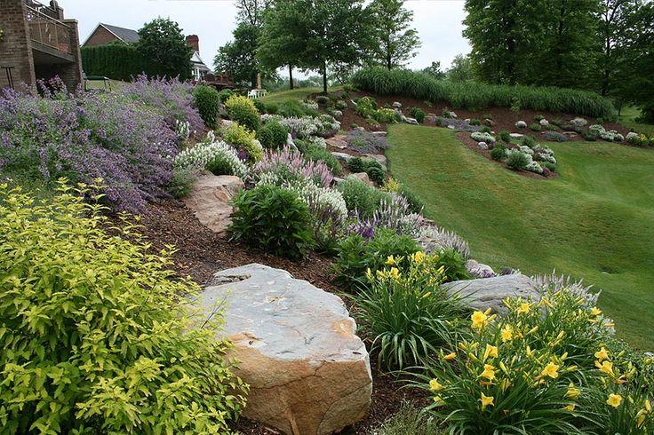 landscaping with big rocks on hillside gardening sloped backyard landscaping backyard hill. Black Bedroom Furniture Sets. Home Design Ideas