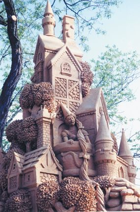 Sand art sculpture - castle with Rapunzle and her long hair depicted from the fairy tale.