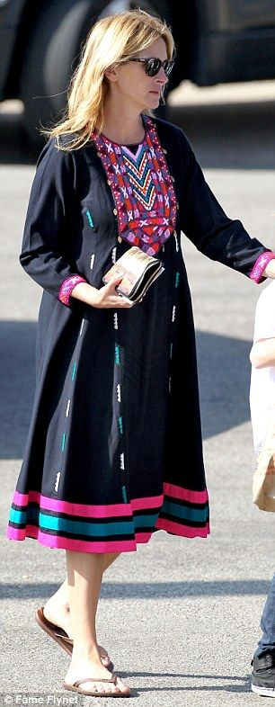 Hands on mother: Julia Roberts sported a black colourful dress as she took children Phinna...