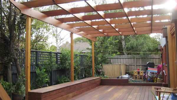 Spotted gum pergola over recessed decking with storage seat spanning the entire lenth