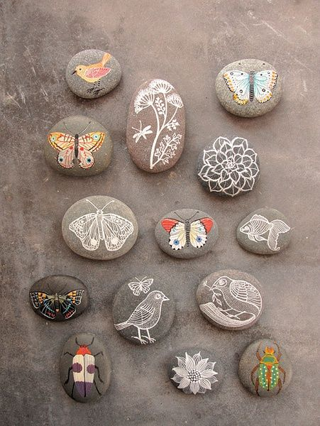 painted stones diy. butterflies, flowers, insects, and fish.