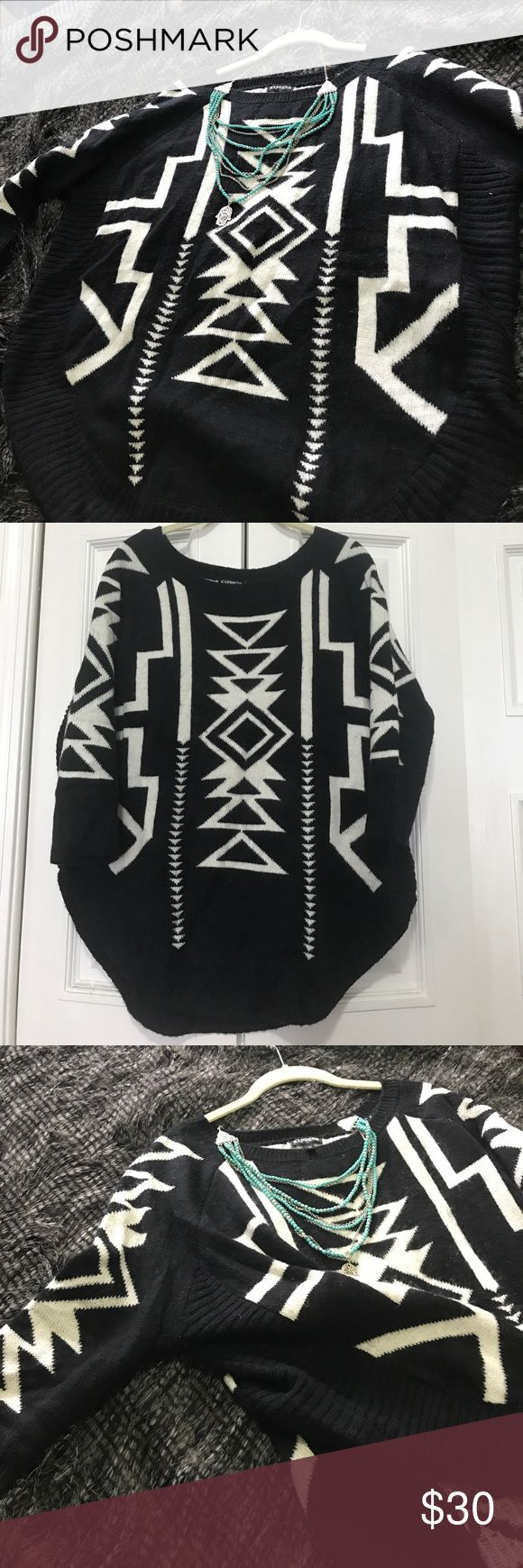 Express Black & White Tribal Sweater Knitted black and white tribal express sweater. Quarter length sleeves. Oversized fit size M. Super cozy and trendy! Express Sweaters Shrugs & Ponchos